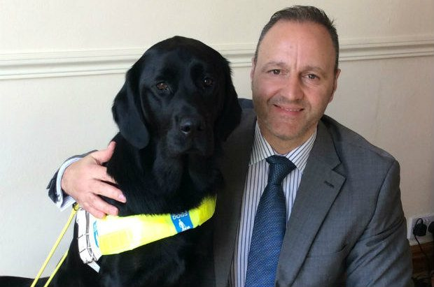 Steven and his guide dog Questa