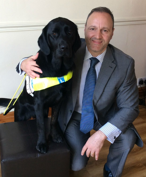 Photo of Steven and his guide dog Questa