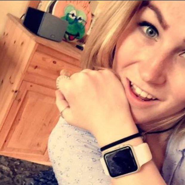 A photograph of Molly Watt with an Apple Watch