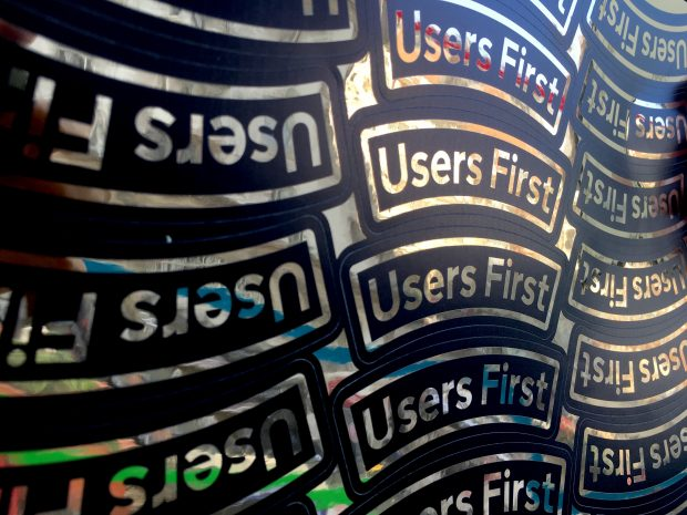 A sheet of stickers saying 'users first'