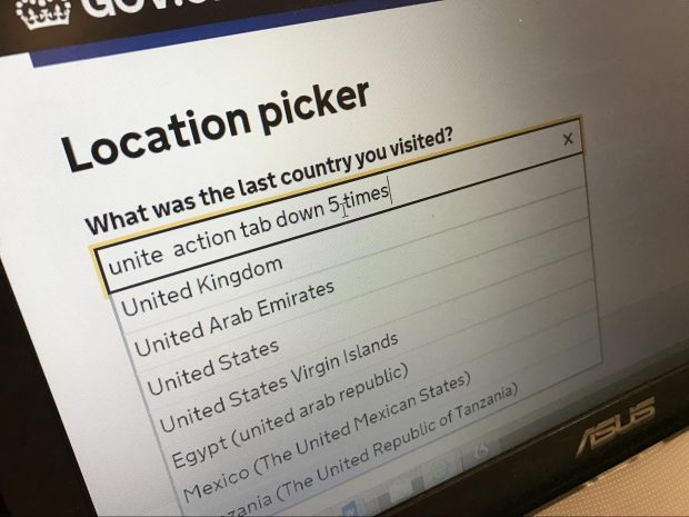 "An image of the autocomplete in use. The text in the textbox reads ""unite action tab down 5 times"". There are a set of seven country results below."