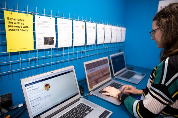 A woman using the Accessibility Empathy Lab at the Government Digital Service