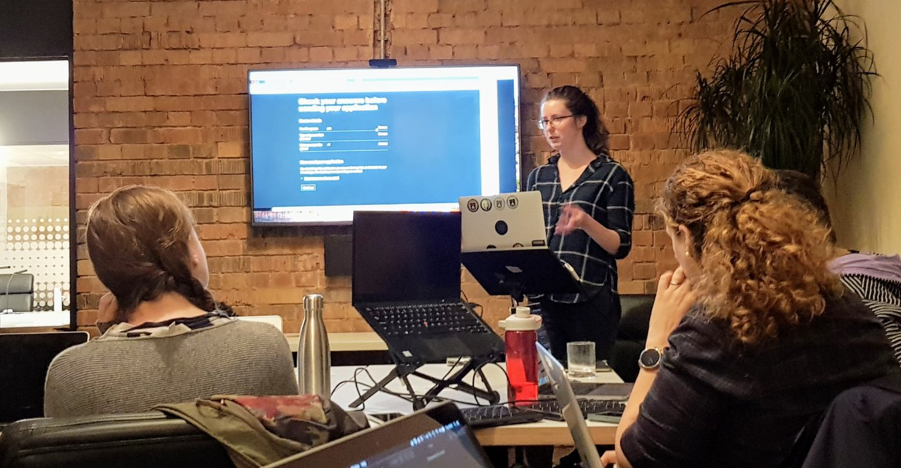 Beverley presenting website to an audience at Front End Sheffield
