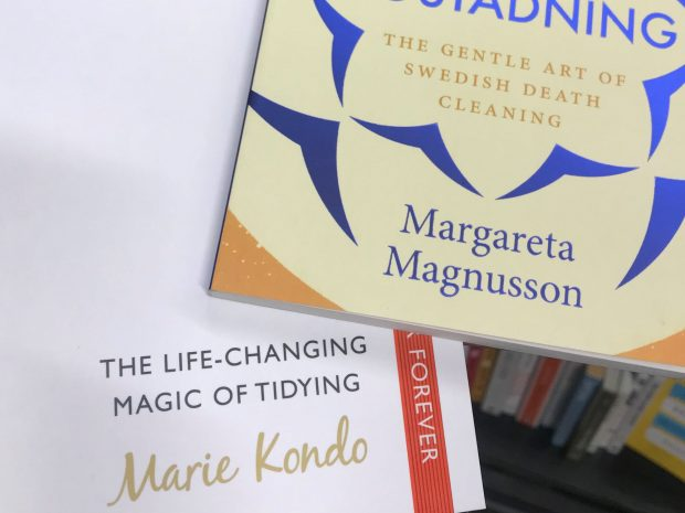 Book covers of Margareta Magnusson's 'The gentle art of Swedish death cleaning' and Marie Kondo's 'The life-changing magic of tidying'.