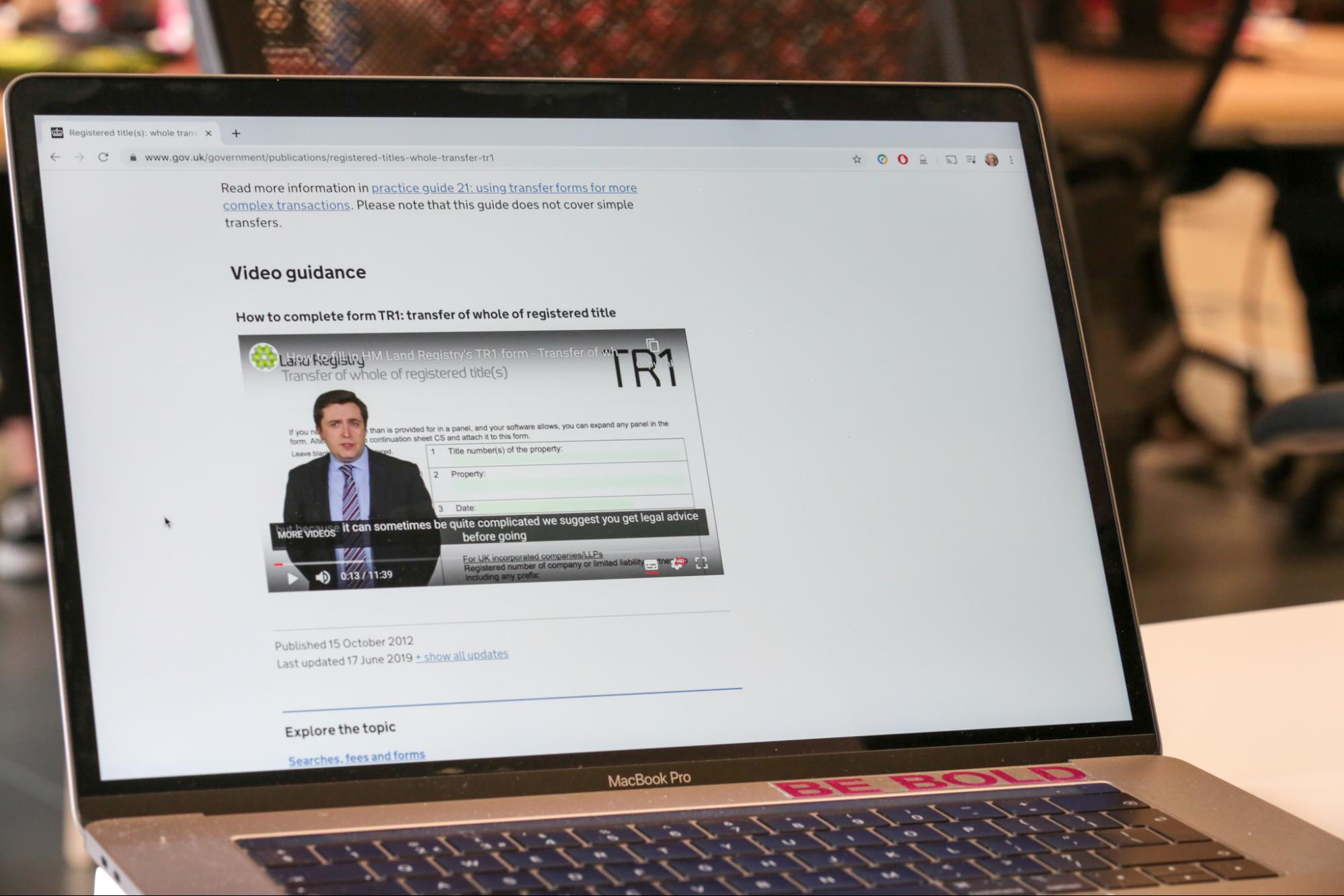 Laptop showing a video player on a GOV.UK page