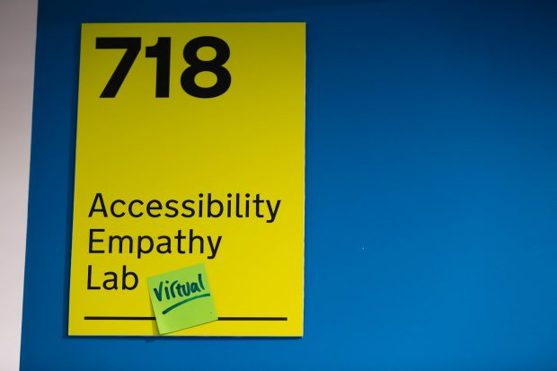 Accessibility Empathy Lab sign with sticky note which says 'virtual' on it.